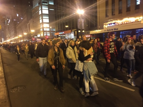 Protesters embracing in the street.