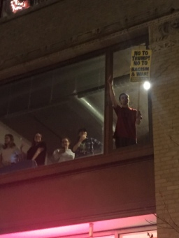 Protesters join from the windows above.